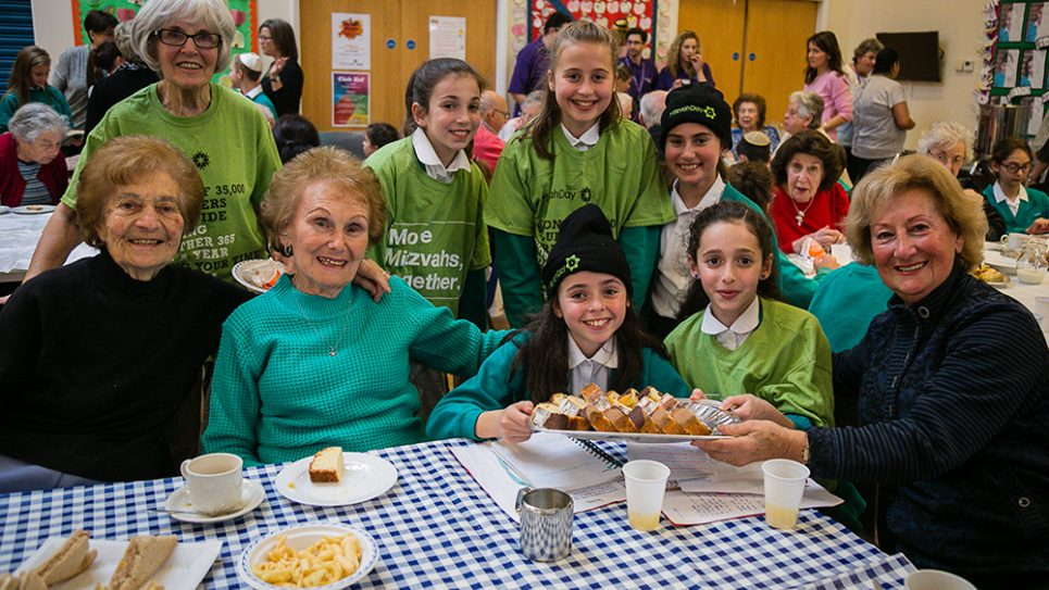 Clore Tikva Primary School held a WW2 themed tea and dance for Redbridge Jewish Community Centre members and clients of Jewish Care - picture by Yakir Zur