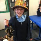 A student at  Keser Torah in Gateshead holding goats hooves, used as an instrument