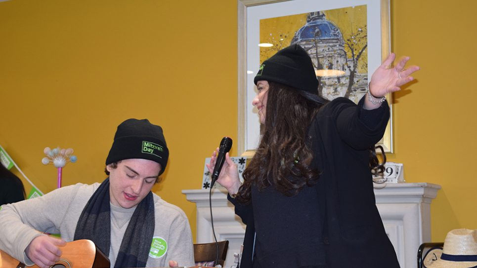 Jewish Care's Six Sunday volunteers entertaining residents at Kun Mor and George Kiss Home