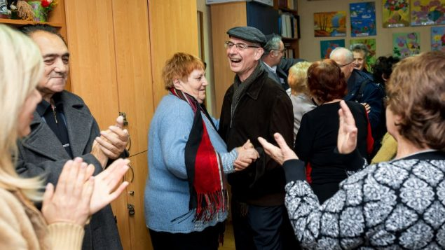 Mike Posen and other members of Golders Green Synagogue join in a social activity at the Jewish Community Centre, Zaporizhia