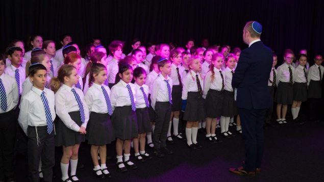 Students at the new school singing