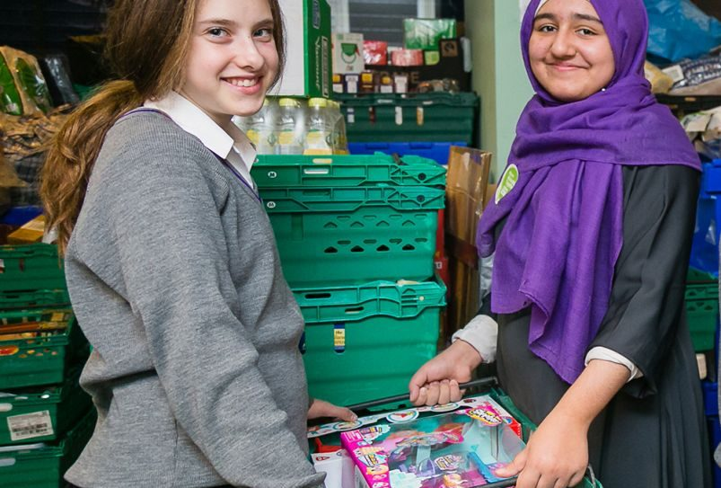 Muslim and Jewish pupils from JCOSS and Lady Nafisa schools working in the warehouse for charity Sufra - picture by Yakir Zur