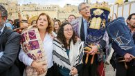 American and Israeli Reform Jews carry Torah scrolls to the Kotel to celebrate the ordination of the 100th rabbi from Hebrew Union College in Jerusalem. Rabbi Noa Sattath, center, is flanked by Anat Hoffman and Rabbi Rick Jacobs.