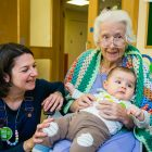 Three generations meet as Apples and Honey Nursery visit Nightingale House care home in Wimbledon - picture by Yakir Zur
