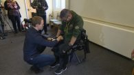 Chris Baker putting on an exoskeleton suit  Picture: Screenshot from ITN