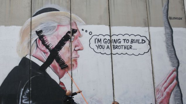 Donald Trump graffiti is daubed with a large black X, showing opposition to his plan to move the embassy to Jerusalem