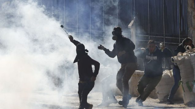 Palestinians clash with Israeli troops during a protest against U.S. President Donald Trump's decision to recognize Jerusalem as the capital of Israel in the West Bank city of Bethlehem, Friday, Dec.8, 2017.(AP Photo/Nasser Shiyoukhi)