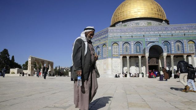 A Palestinian walks in front of the Dome of the Rock ahead of the prayers in Jerusalem, Friday, Dec. 8, 2017. Israeli police deployed reinforcements in and around Jerusalem's Old City on Friday, in anticipation of Palestinian protests over the Trump administration's recognition of the contested city as the Israeli capital. (AP Photo/Mahmoud Illean)