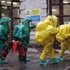 Members of the police, fire brigade and ambulance service during a joint exercise to test their response to a ÔHAZMATÕ type ncident involving a hazardous substance, at the Israeli Embassy in Kensington, London. PRESS ASSOCIATION Photo. Picture date: Sunday December 10, 2017. Emergency teams in bio suits descended on the Israeli embassy in a training exercise for a hazardous chemical incident. A cordon was put in place and decontamination tents were erected at the back of the building in central London, yards from Kensington Palace. See PA story POLICE Israeli. Photo credit should read: Yui Mok/PA Wire