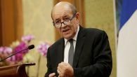 French Foreign Minister Jean-Yves Le Drian attends a joint news conference in Beijing