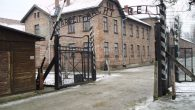 Auschwitz gate with the infamous 'Arbeit Macht Frei' - works makes you free - above the entrance