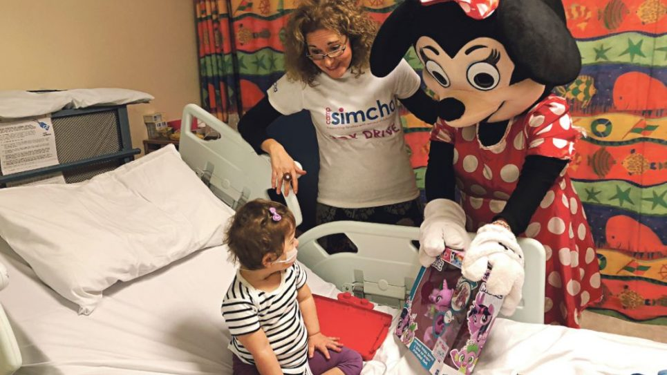 Minnie Mouse helps brighten up the day of a young patient in Barnet Hospital's Galaxy ward
