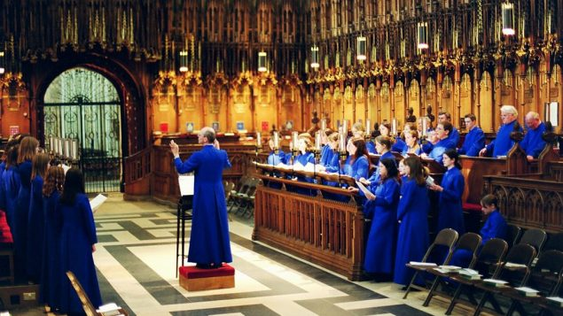 A choir singing choral evensong in York Minster