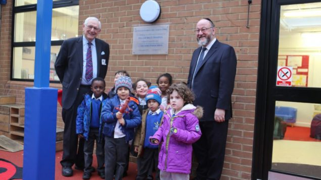 First two are the Chief with Peter Ohrenstein, trustee of Simon Marks school. and some students