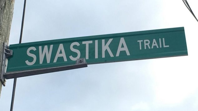 A Swastika Trail street sign hanging in Puslinch Township, Canada. (Screenshot from YouTube)
