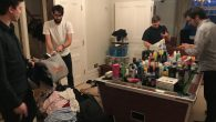 Four sibling volunteers of the Linkey Initiative, (L-R) Jonny Langleben, Joel Bowman, Josh Adley and Adam Langleben, sorting goods for the homeless