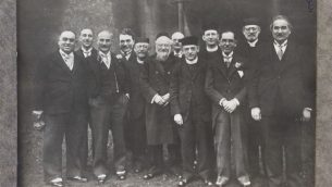 Photograph of members and clergy of Cardiff's Jewish community; identified: Abe Schwartz, JE Rivlin, the Reverend Harris Jerevitch, the Reverend Gershon Grey, MJ Cohen, the Rabbi of Newport (name unknown), the Reverend Harris Hamburg, Alter Rivlin, Rabbi Grunitz; photographer: S Edelman; c.1920; Glamorgan Archives ref. DJR/5/21.