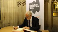 Jeremy Corbyn signing the Holocaust Educational Trust's book of commitment