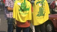 Hezbollah flags draped over teenagers at the Al Quds Day march