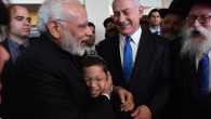 Indian Prime Minister, left, embracing 11-year-old Moshe Holtzberg