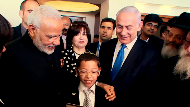 PM Netanyahu and Indian PM Modi meet with Moshe Holtzberg during the Indian leaders visit to the Jewish state in July 2017