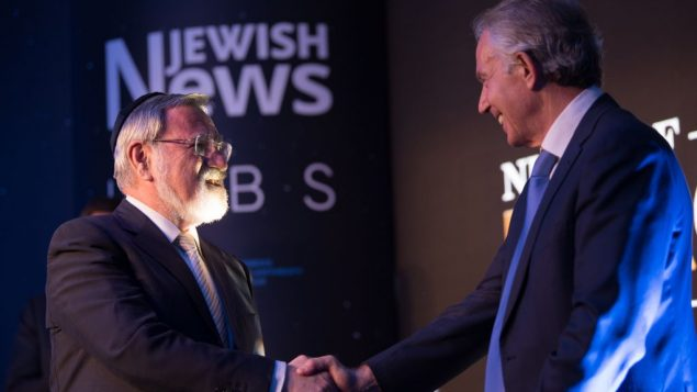 Tony Blair embraces emeritus Chief Rabbi Lord Sacks as he's awarded his Lifetime Achievement honour  at the Night of Heroes   Credit: Blake Ezra