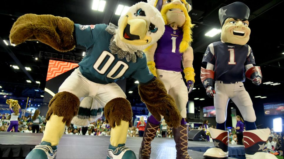 The Philadelphia Eagles, Minnesota Vikings and New England Patriots mascots are seen onstage before the JoJo Siwa performs at Nickelodeon at the Super Bowl Expereince during NFL Play 60 Kids Day on January 31, 2018 in Minneapolis, Minnesota.