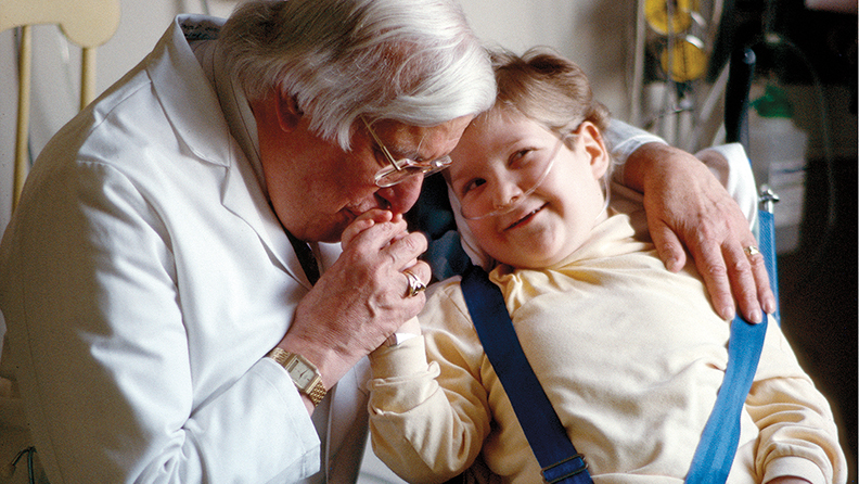 Dr. Arnold P. Gold with a patient, Christopher Savage, in the 1990s at the Babies Hospital at the NewYork Presbyterian-Columbia University campus (now Morgan Stanley Children's Hospital).