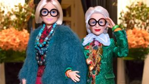 A Barbie doll in the image of Iris Apfel, right.