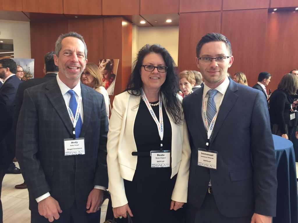 Andy Siegel of Siegel Insurance mingles with GATC-LP Chief Financial Officer Beate Stagnet and Vice President Immanuel Otterski
