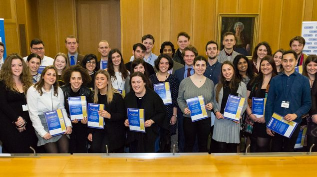 Graduates of the programme holding their certificates at the House of Lords ceremony