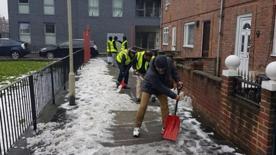 Jews and Muslims in East London shovelling snow on a freezing cold Sadaqa Day