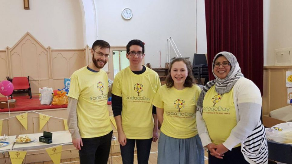 Members of Glasgow University Jewish Society and the Scottish Police Muslim Association at Hillington Park Parish Church donating food parcels to the Glasgow SW Food Bank
