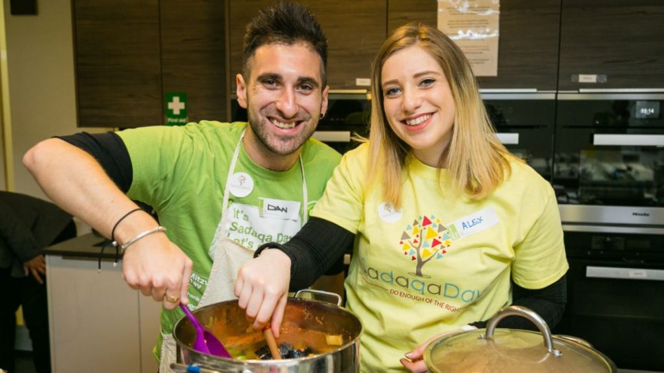 Mitzvah Day Executive Director Dan Rickman and his wife Alexandra Rickman cooking for the Sufra NW at JW3 - picture by Yakir Zur