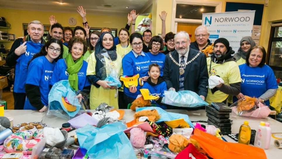 The Mayor of Barnet Brian Salinger and Mitzvah Day Executive Director Dan Rickman joined Norwood service users to pack for Sufra NW