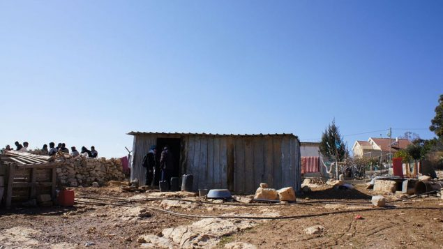 The rubble of a home demolished by the IDF, with a tin shack that a family no has to live in, in Umm al-Khair.