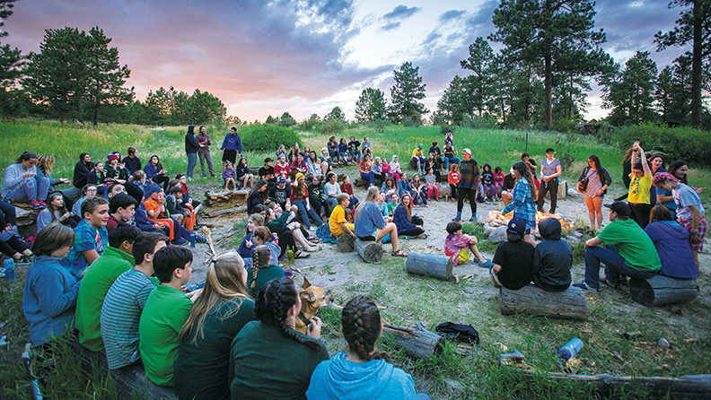 Campers sing around the campfire at JCC Ranch Camp in California
