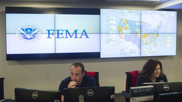 Employees inside the FEMA Command Center