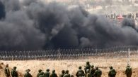 Israeli soldiers take position as Palestinians protest on the Israel Gaza Strip Border, Friday, April 13, 2018. (AP Photo/Ariel Schalit)