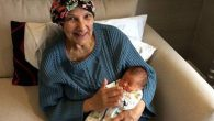 Hilary Levinson holding her 10-week-old grandson Jacob.   Photo credit: Anthony Nolan/PA Wire