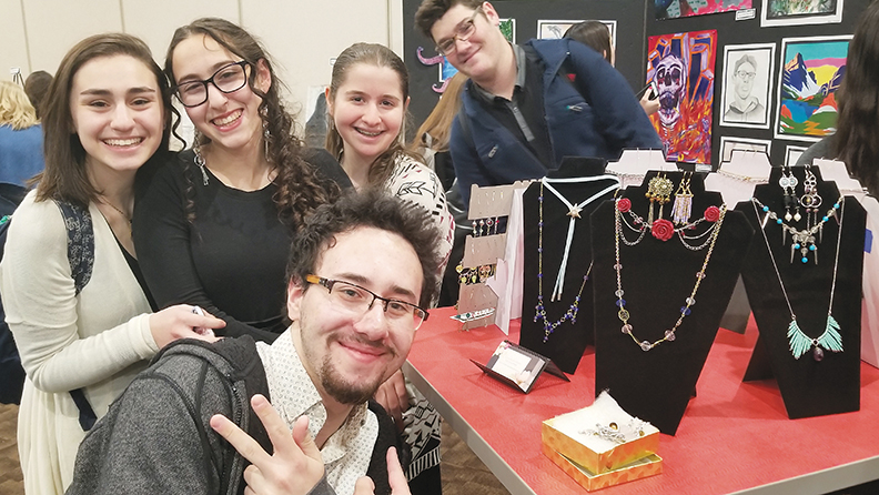 Leora Barkai, second from left, designed the jewelry  shown here; she is surrounded by friends in the art track.