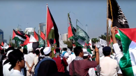 Palestinian, Indonesian and Islamist flags laden the protest in Jakarta