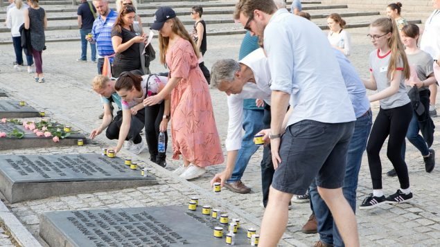 The group concluded their trip to Auschwitz by lighting memorial candles. Picture: Holocaust Educational Trust