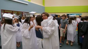 ED-Davis Ava Stark and Jessie Schulhof share a goodbye hug before they leave for high school.