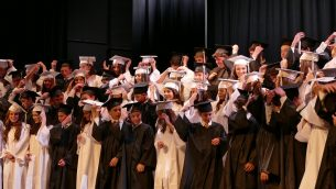 ED-Davis With the flip of their tassels, members of the Class of 2018 show that they are Davis Academy graduates.