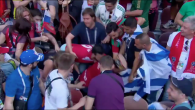 Morocco fans try to rip away an Israeli flag during their game versus Portugal