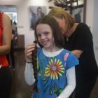The Zichron Menachem event, which saw 16 Jewish girls have their hair cut for charity, in aid of Israeli youngsters with cancer.   Credit: Zichron Menachem