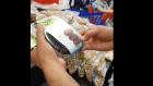 Screenshot of video, where activist removes Israeli dates from Carrefour supermarket