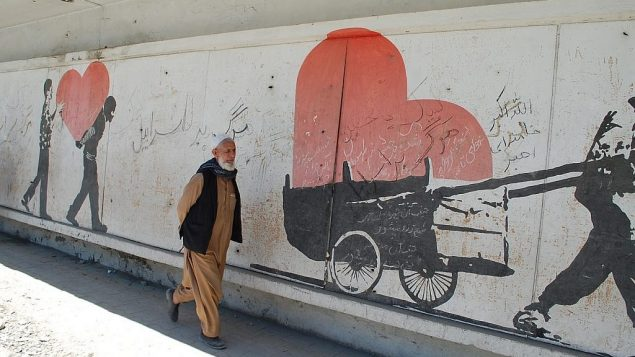 An-Afghan-man-passes-by-a-Kabul-street-where-the-slogans-of-Deaht-to-Israel-appear.-Image-Credit-Ezzatullah-Mehrdad-e1561553439160-1024x640
