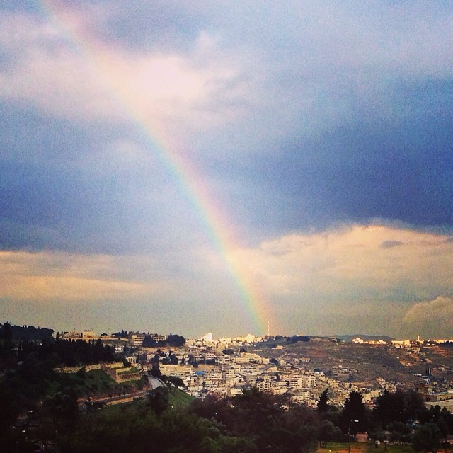 A beautiful rainbow shines over Jerusalem.